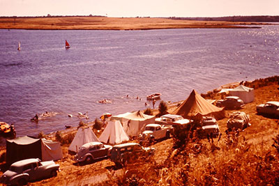 Wall to wall tents and caravans along Sunset Drive, Newlands Arm, 1960